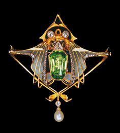 Gold pendant in the form of a scarab, diamond eyes the body set with a peridot with cut corners, lines of diamonds highlighting the plique-a-jour enamel wings, within a gold triangle hung with a pearl. L. Gautrait, Paris , c. 1900