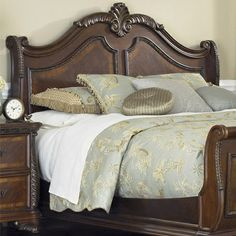 Ornate carved wooden bed frame
