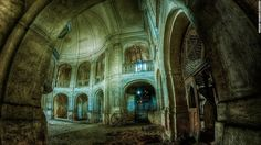 """Many of Makowska's images are given enigmatic names. This photograph, possibly of a derelict church, is titled """"Darkness."""""""