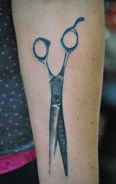 I like the simplicity and realism. Save your scissors could be small lettering by the blades.