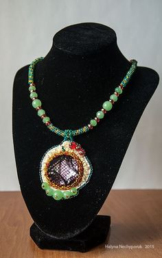 Materials: Czech beads, jade, jade natural, Czech beads preciosa, Czech crystal, acrylic rhinestones, lace, leather, silver-plated fittings, furniture, silk thread.  Sizes Pendant: 7h5,5 Harness: 46 + 6cm Weight: 42gr $ 16