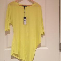 BCBGMaxazria yellow asymmetrical short sleeved top Thin, light weight, asymmetrical, yellow short sleeved top. Never been worn. New with tags! BCBGMaxAzria Tops Tees - Short Sleeve