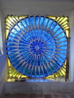 GORGEOUS!...Window made from reycled glass bottles. Allows colorful to pass through while keeping your privacy.