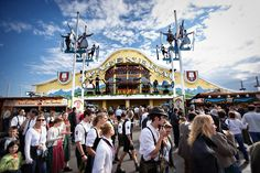 Hundreds of people are walking around in Munich, Germany outside the Spaten tent for Oktoberfest. Germany Europe, Munich Germany, Fine Art Photo, Photo Art, Europe Photos, Places To Travel, Places Ive Been, Tent, The Outsiders
