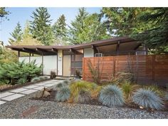 Mid century exterior with slatted fencing