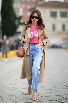 Miroslava Duma wearing Vetements jeans, a vintage t-shirt, a trench coat,  and Gucci heels.