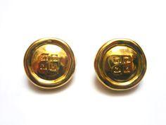 GIVENCHY Boucles d'oreilles . Clips en métal doré . Logo . Vintage Années 80
