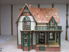 All wood new and unsued Dura Craft Heritage dollhouse