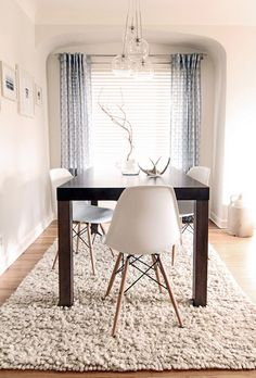 eiffel chairs with dark wood table.  White rug