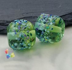 °☆° Glass lampwork beads for jewellery making, because amazing jewellery starts with beautiful beads. °☆• Gorgeous beads in green and blue that have been graduated to make them two tone. The middle has a fine black detail and decorated with a colourful frit blend that has been