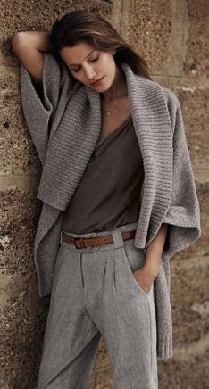Classic and elegant with a modern flair. Love the grey flannel slacks, and the beautiful grey knitted sweater jacket - very Katherine Hepburn in 2013!