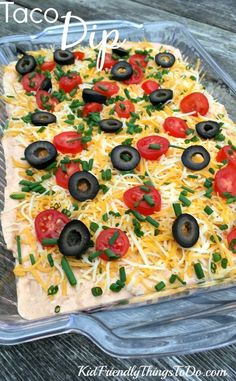 Easy Peasy Taco Dip - This is a huge hit with family and friends. Done in 10 minutes, it's perfect for holiday gatherings, game night, and parties!