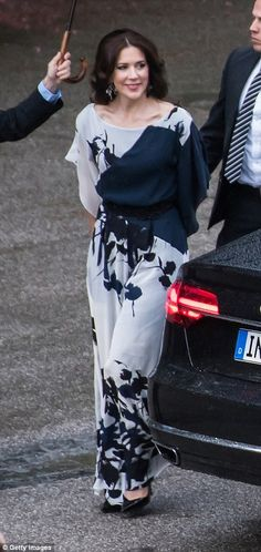 Jump to it: Crown Princess Mary swapped her usual regal gowns for a striking jumpsuit at a...