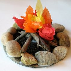 This is adorable! You use an old CD, rocks, sticks, dirt, and tissue paper to make a campfire... I'm going to do this on a bigger scale & have Bible stories around a campfire one day! :) Kids will LOVE it!