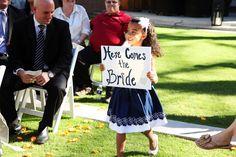 Adorable flower girl announcing the bride...