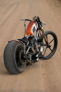 hardtail panhead custom with small vintage scrambler tank, tank shift and springer spool front end