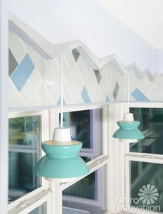 Retro Renovation - mid century styled pendant lights help support the vintage vibe of the space