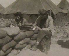 Two Army nurses writing letters home ~