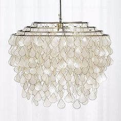 Bring island vibes home with this chandelier crafted out of iridescent capiz shells.