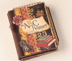 ABC Primer Scrapbook Mini Album - unique gift for a teacher or to scrap your old school photos. $105.00, via Etsy.