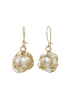 Hand made Gold and Pearl drop earrings. Pearls are classic wear everyday. With jeans on the weekend a suit to work or all dressed up for a party! Earrings fall about a half inch from the ear lobe. Pearls are organic shell and wrapped in 14K gold filled wire. Ear wire is 14K gold filled and locks in the back for security.  Wrapped Pearl Earrings by Anne Woodman. Accessories - Jewelry - Earrings Brooklyn New York City