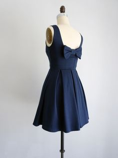 JANUARY | Navy Blue by Apricity. Made in Los Angeles. vintage inspired short bridesmaid dress with pockets, back bow and full pleated skirt