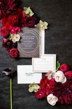 W Hoboken wedding photos by Mikkel Paige Photography at this NJ venue. Pictures in this well known New Jersey city with a view of the NYC skyline. This detail image includes a black and gold invitation from Minted, and flowers from Sachi Rose designed in a lay flat suite by the photographer. Red, fuchsia and burgundy peonies, calla lilies, Japanese roses, helebores dahlias and ranunculus complete the scene. #mikkelpaige #HobokenWedding #NewJerseyPhotographer #NewYorkCityPhotographer…
