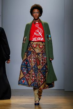 Ms. Jean, known for her blending of classic Italian and Hatian themes, presents her fall looks.