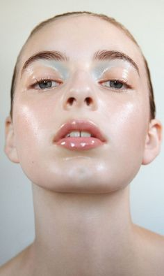 Bright baby blue eyeshadow with glowing skin and glossy lips. - Beauty Inspiration