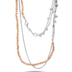 This stunning double chain necklace is made with pink freshwater pearls and sterling silver. Delicate little silver details in the chain move and catch the light in a most beautiful way. Perfect for a beautiful layered look.