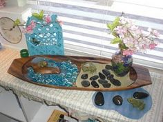 Pond themed nature table play.