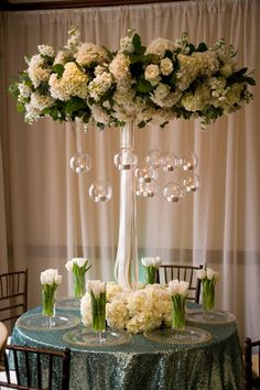 Tall centrepiece with hanging glass baubles - white wedding flowers