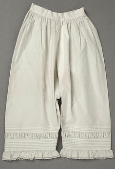 Pioneer-era white cottondrawers are not shaped like  PJ pants; use the historic shape, and you'll stay comfortable, like they did! These are fancy, with tucks, puffing insertion, and a frill at the hem. Plain hems are great, too! Drawers    Date:      1863  Culture:      American or European