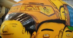 Detail of the windows, airplane graffited by Os Gêmeos to the Brazil national football team - FIFA World Cup 2014.