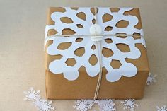 snowflake Christmas wrap. Have kids cut the snowflakes