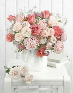 white and pink flowers in white vase