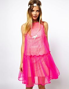 My favorite piece by the Central St. Martins 2012 graduate is the neon coral tulle smock dress .           Here's Susie Bubble  wearing the...