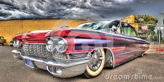 Custom painted and designed purple and red 1960s Cadillac on display at a car show in Melbourne, Australia.