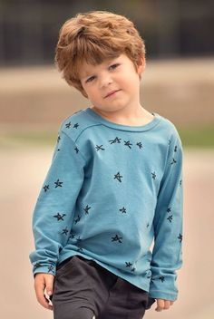 He'll love checking out these graphics of hand-drawn stars as he stargazes on camping trips and dreams of rocket ships during recess in this charming boys' tee that is just the inspiration he needs this fall.Pictured here with the Graphite Slouch Pants (sold separately)Sky blue fabric is a soft jersey knit Made in the USA Designed by Joah Love