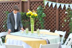 I love everything about this centerpiece and candles and table cloth!