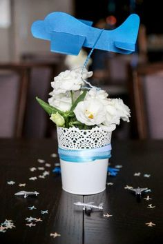 paper airplane topper for centerpiece The pot/vase are in Target's dollar bins right now (3-2017)