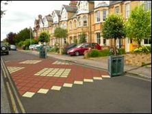Street Design, Traffic calming, Urban Street. Beech Croft Road Traffic calming by residents. Like the planters on both sides of crossing as well as colour and painting size. Perfect balance between size and function. Assume it was not too expensive.