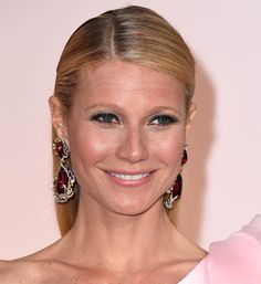 Oscar Winning Actress & Presenter Gwenyth Paltrow donned a pale pink custom Ralph & Russo dress with a large rose motiff on her left shoulder. Although the dress received much criticism, she scored big with jewelry. G.P.'s straight slick back hair revealed bold pair of 'Fire Phoenix' earrings consisting of two pear-shaped cabochon rubellites weighing 101 carats surrounded by an array of white and yellow diamonds, blue, pink and purple sapphires, spinels and paraiba tourmalines in white gold.