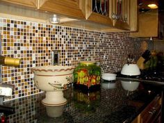 Kitchen backsplashes with glass tiles