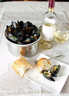 Mussels baked with butter, garlic, and parsley. You'll want lots of crusty bread to sop up all the juices!