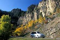 pearfish Canyon State and National Forest Service Scenic Byway  Flanked by towering limestone cliffs, this 20-mile route along US 14A, cuts through Spearfish Canyon in the Black Hills. A forest of spruce, pine, aspen, birch and oak covers the hillsides while Spearfish Creek flows along the canyon bottom.    Bridal Veil and Roughlock Falls are highlights along the route. Summer's lush greenery gives way to brilliant fall foliage.