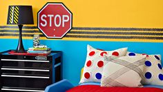 bedroom wall painted yellow on top and blue on the bottom with tire track border between - two color kids bedroom painting idea