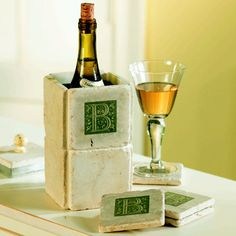 very personal way to drink and be merry. Beautifully rustic tumbled Botticino Marble tiles come in your choice of Renaissance style initial. Wine Chiller pre-cools in the refrigerator and has a metal sleeve to hold moisture. Coasters have clear moisture-resistant coating.