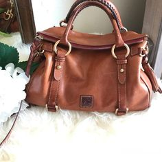 """Shop Women's Dooney & Bourke size 13""""W x 8""""H x 5- 3/4""""D Satchels at a discounted price at Poshmark. Description: EUC!  BeautifulDooney & Bourke Florentine Satchel in color Natural Smoke free home. Sold by cindy_anaid. Fast delivery, full service customer support."""