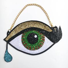 Hazel Glitter Eye Clutch Handbag Glitter Eye, Blue Glitter, Glitter Fabric, Eye Shapes, Clutch Bags, Coaches, Black Fabric, My Bags, Evening Bags